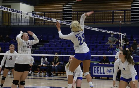 Bell County's Makenna Lefevers went airborne at the net as Harlan County's Lindsey Browning prepared for a block in championship game action Tuesday in the 52nd District Tournament.
