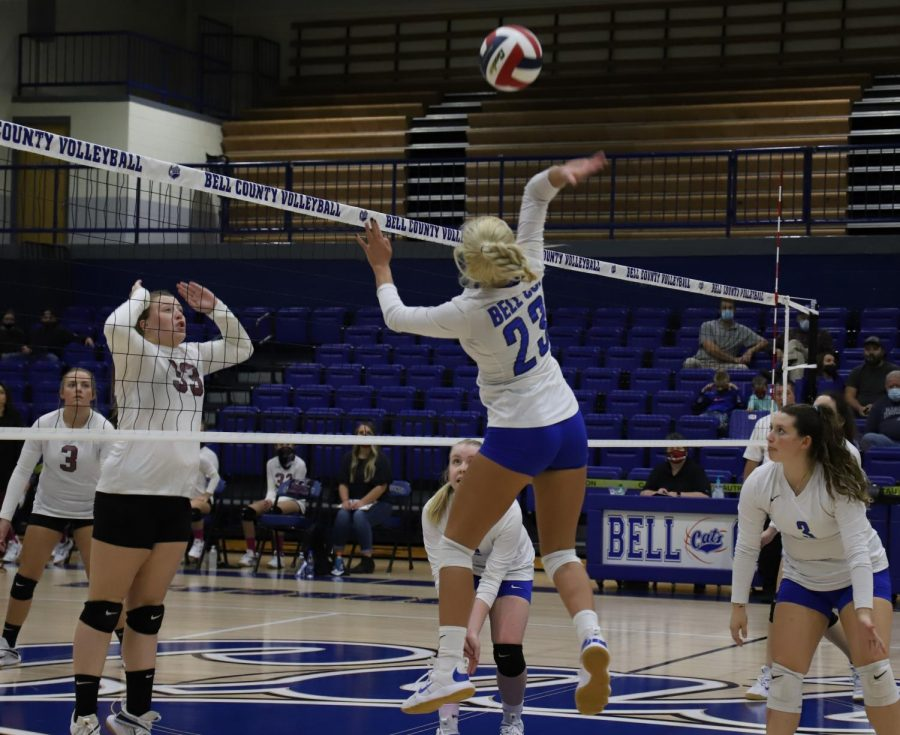 Bell+County%E2%80%99s+Makenna+Lefevers+went+airborne+at+the+net+as+Harlan+County%E2%80%99s+Lindsey+Browning+prepared+for+a+block+in+championship+game+action+Tuesday+in+the+52nd+District+Tournament.%0A