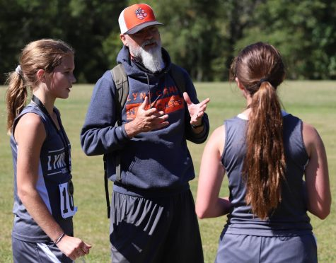 Lynn Camp cross country coach Marc Estep talked to two members of his team during the Black Bear Invitational on Saturday. Estep was a member of three regional championship cross country teams under Leo Miller at Harlan from 1985 to 1987 and was a state champion in track in the 800 meters.