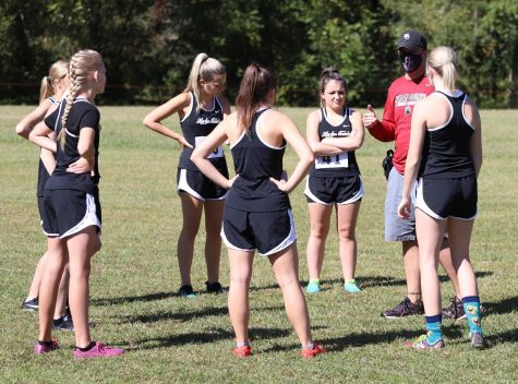 Harlan County track and cross country coach Ryan Vitatoe talked with his team during a cross country meet in the fall.
