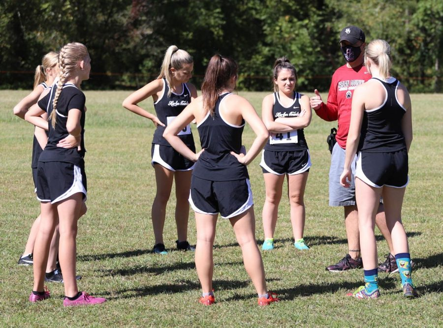 Harlan+County+track+and+cross+country+coach+Ryan+Vitatoe+talked+with+his+team+during+a+cross+country+meet+in+the+fall.