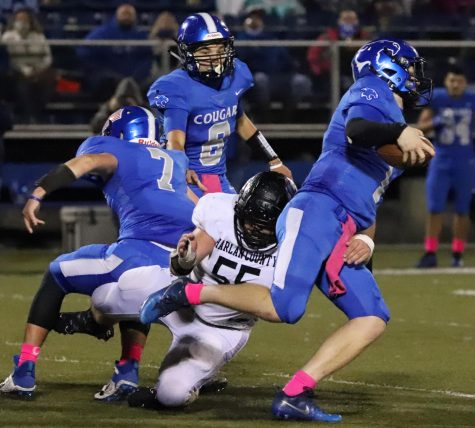 Letcher Central quarterback Carson Adams battled to break free from Harlan County linebacker Hunter Blevins in Friday