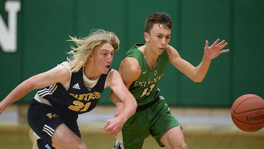 Harlan's Dylan Cox battled for a loose ball against Knox Central in middle school basketball action Friday. Cox led the Green Dragons with 13 points in a 43-29 loss to the Panthers.