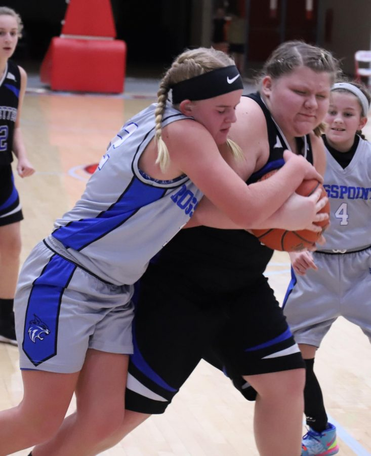Black Mountain's Julia Vick battled with Rosspoint's Shasta Brackett for possession of the basketball in Monday's fifth- and sixth-grade game.