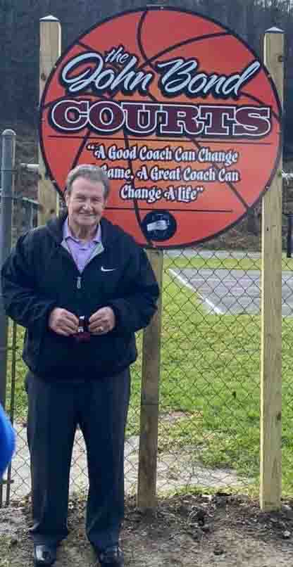 Former Cumberland girls basketball coach John Bond was honored Saturday when the basketball courts at the Walter Dick Park in Benham were named in his honor.