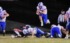Bell County's Brandon Baker went airborne on the way to a big gain in Friday's 13-6 win over Rockcastle County. Baker ran for 179 yards and scored two touchdowns in the victory.