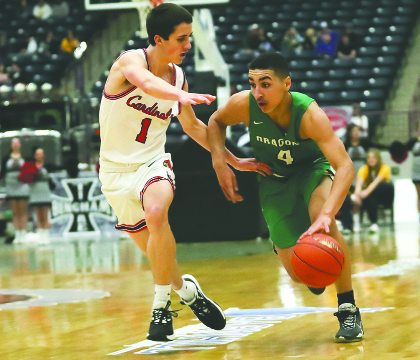 Junior+guard+Kaleb+McLendon%2C+pictured+in+last+year%27s+regional+tournament+against+Clay+County%2C+is+one+of+four+starters+back+for+the+Green+Dragons+this+year.+Harlan+will+open+its+schedule+on+Jan.+4+at+Elliott+County.