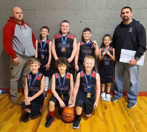 "The Bulls, a local third-grade AAU basketball team, won the Border Wars tournament over the weekend in Bristol. It was the Bulls' fourth tourney title of the season as they improved their record to 28-11. Members of the team, include, from left, front row: Sam Carmical, Brycen Saylor and Blake Johnson; back row: coach Jason Sanders, Trey Creech, Adrian ""Brother"" Fields, Carson Sanders, Natalie Creech and coach Eddie Creech."