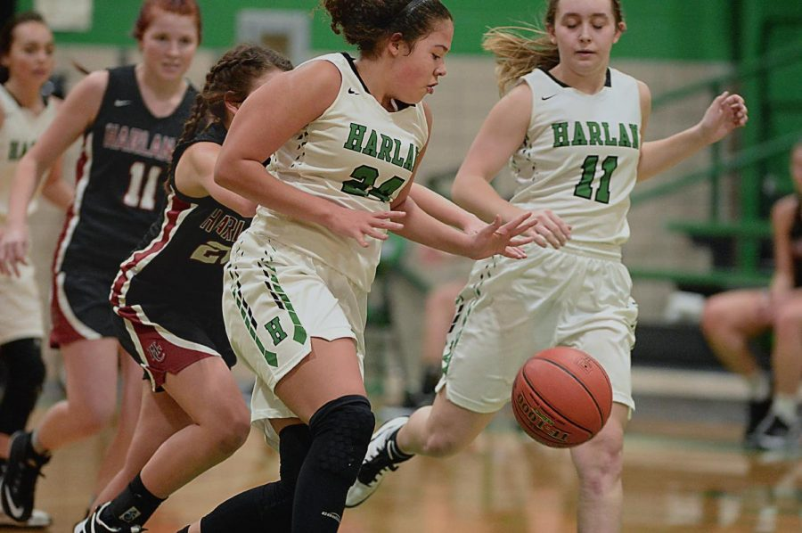 Harlan freshman forward Aymanni Wynn went after a loose ball in Thursday's district game against visiting Harlan County. Wynn led the Lady Dragons with 15 points and 10 rebounds in a 53-45 loss.