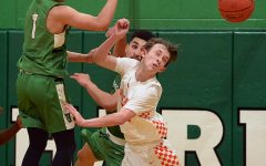 Harlan sophomore guard Kyler McLendon battled for a loose ball in 13th Region All