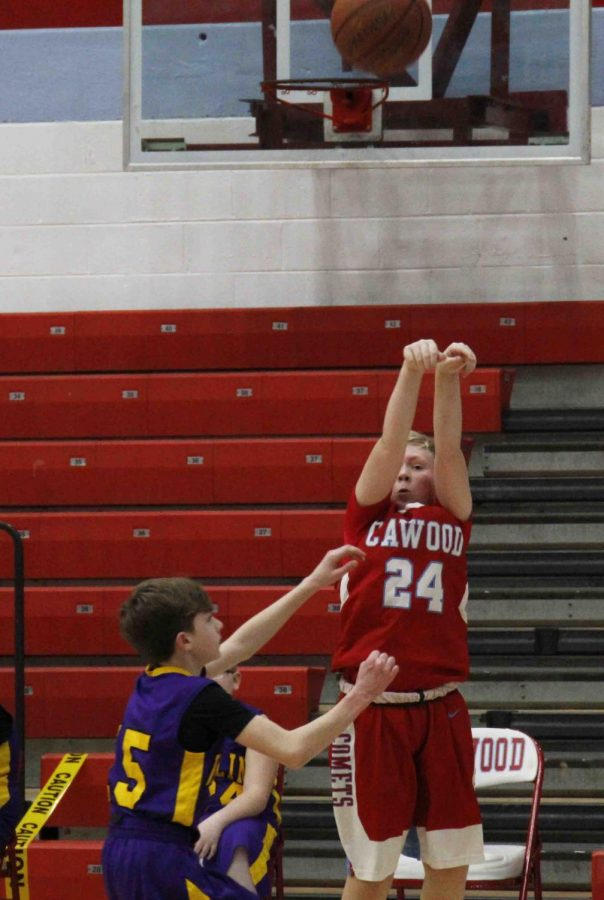 Cawood's Hunter Moore put up a shot in Thursday's game against Wallins.