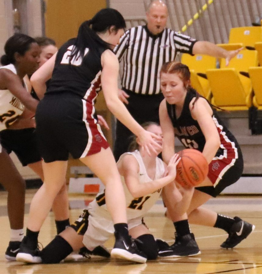 Harlan County's Jaylin Smith (20) and Jacey Lewis (11) battled with Middlesboro's Kamryn Keith in Tuesday's game. Lewis scored 19 points, including four 3-pointers, as HCHS won 64-46.