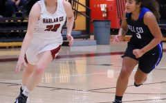 Harlan County junior forward Jaylin Smith raced down the court as Bell County's Nadine Johnson defended. The visiting Lady Cats rolled to a 72-42 win.
