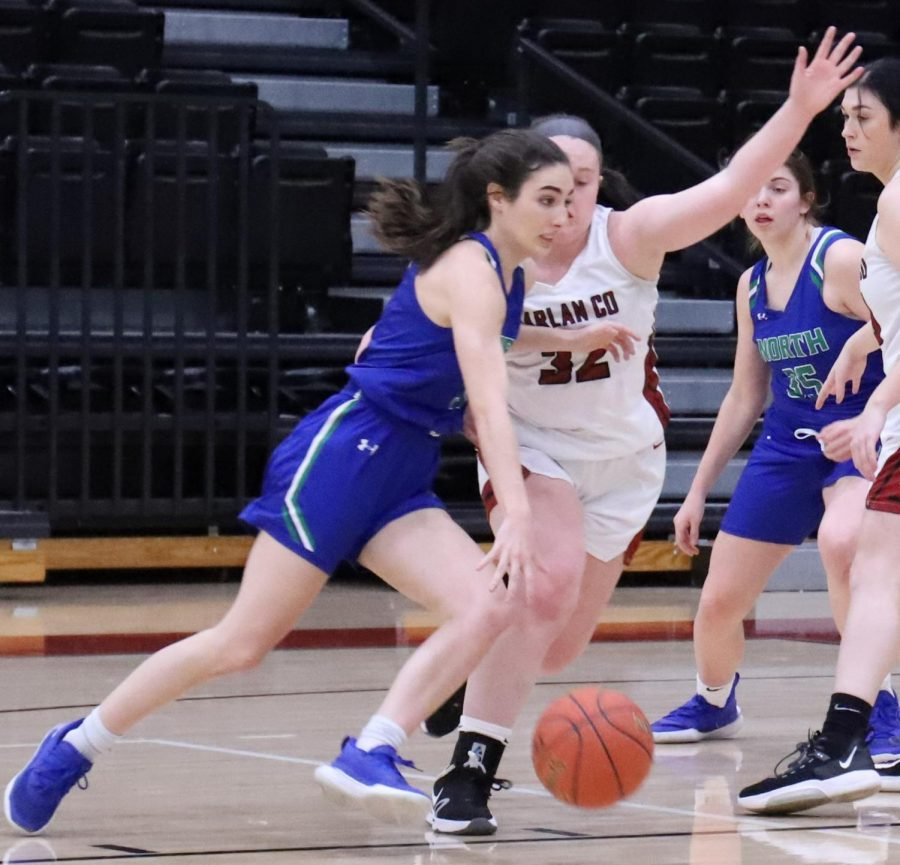 North+Laurel+guard+Hailee+Valentine+drove+against+Harlan+County%27s+Kelly+Beth+Hoskins+in+Thursday%27s+game+at+HCHS.+Valentine+scored+14+points+in+the+Lady+Jaguars%27+60-15+win.