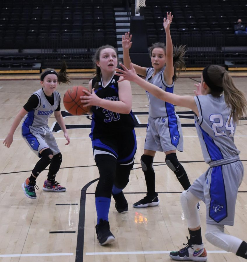 Black Mountain's Addison Campbell headed to the basket against Rosspoint in the fifth- and sixth-grade county finals on Saturday.