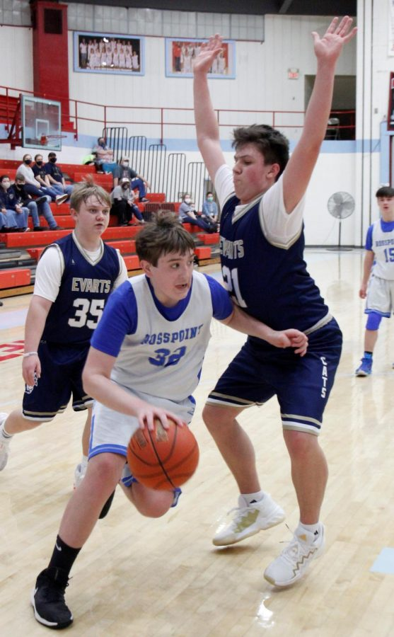 Rosspoint's Brody-Napier worked around Aidan Reynolds, of Evarts, in Tuesday's opening-night action from the county basketball league. Napier scored 14 in Rosspoint's 41-31 victory.
