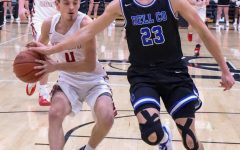 Harlan County sophomore guard Daniel Carmical raced down the court against Bell County's Cameron Burnett in Tuesday's district clash. Carmical hit seven 3-pointers and scored 23 points in the Bears' win.