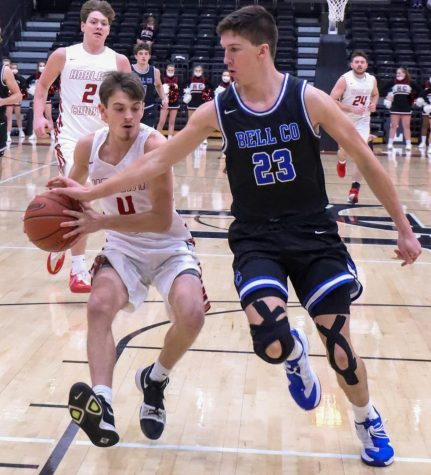 Harlan County sophomore guard Daniel Carmical raced down the court against Bell County