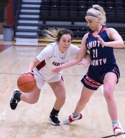 Harlan County sophomore guard Hailey Austin worked against Knott Central