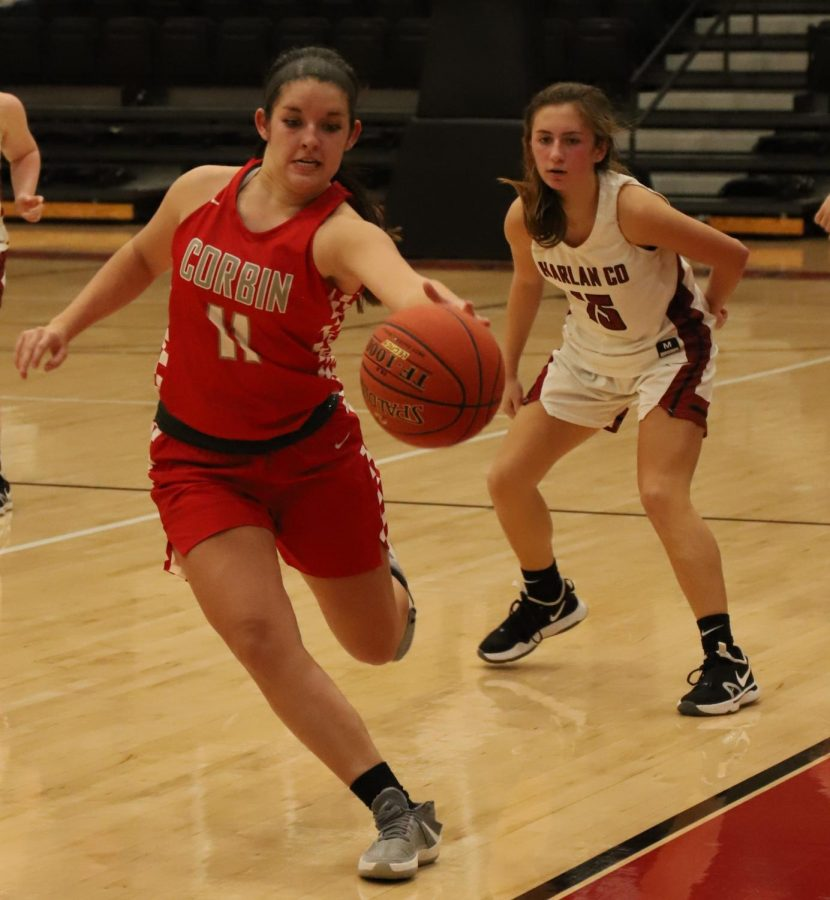 Corbin's Kallie Housley saved the ball during Monday's game at Harlan County. Housley scored 32 points in the Lady Hounds' 80-44 win.