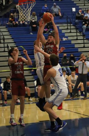 Harlan County senior forward Josh Turner pull down one of his 10 rebounds on Saturday in the Bears