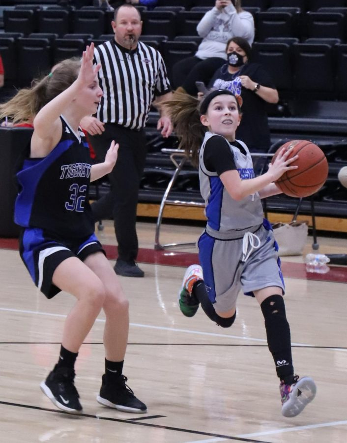 Rosspoint's Reagan Clem went to the basket against Black Mountain's Rheagan Halcomb in the fifth- and sixth-grade county finals. Clem scored 13 points in Rosspoint's 30-23 win.
