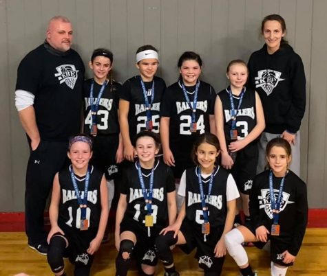 The KBE Ballers include, from left, bottom row: Jaycee Simpson, Reagan Clem, Ella Root and Addy Murray; top row: coach Mitchell Madden, Jaylee Cochran, Olivia Hatfield, Laylee Phillips, Jaslyn Philpot and coach Dana Root.