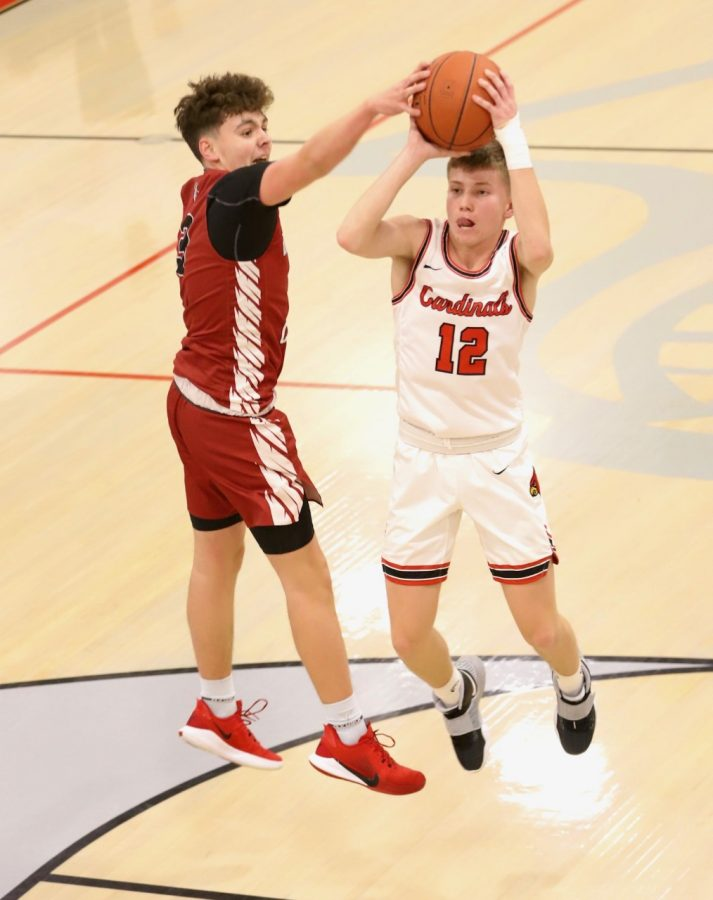 Harlan County's Maddox Huff contested a shot by South Laurel's Ashton Garland in Tuesday's game. Huff scored seven points in the Bears' 53-45 victory.