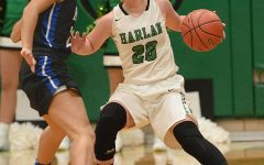 Harlan guard Emma Owens worked around a Bell County defender in Monday's district clash. The visiting Lady Cats capitalized on 38 turnovers in a 76-37 victory.
