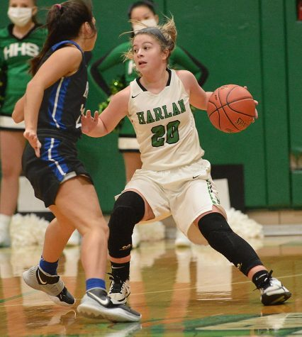 Harlan guard Emma Owens worked around a Bell County defender in Monday