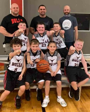 The Bulls, a local AAU team, won the Model City Madness Tourney over the weekend in Bristol. Team members include, from left, front row: Brycen Saylor, Sam Carmical, Natalie Creech and Blake Johnson; middle row: Carson Sanders, Adrian Fields and Trey Creech; back row: coaches Jason Sanders, Eddie Creech and Derrick Saylor.