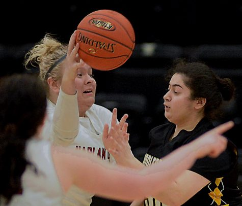 Harlan County center Taylor Lunsford passed the ball during Saturday