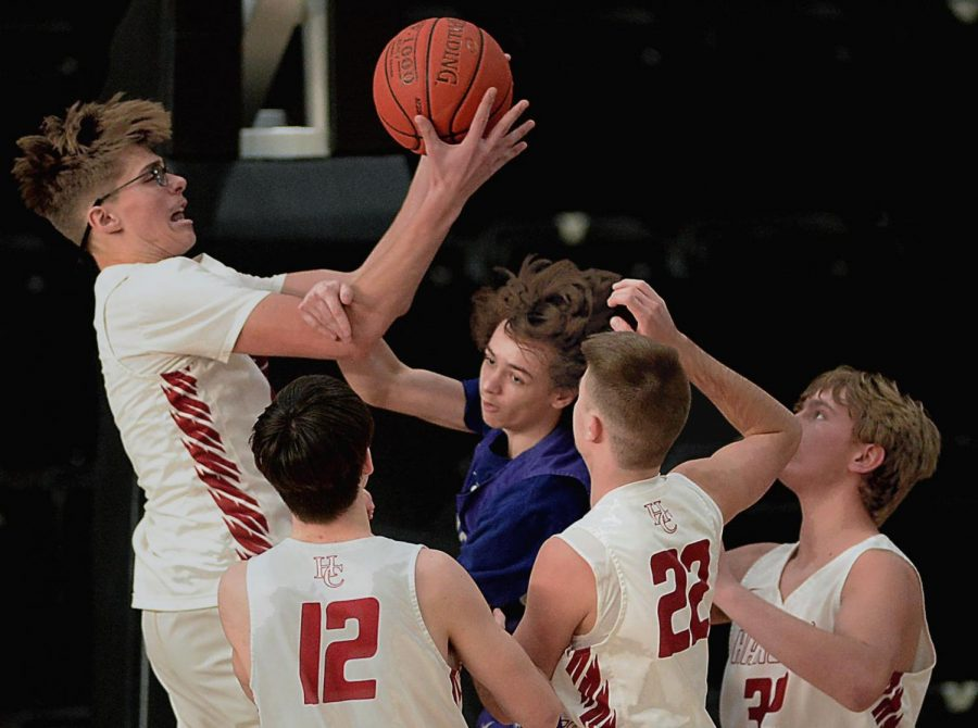 Harlan County freshman Jared Rhymer battled for the ball in Saturday's game against Buckhorn. The Bears improved to 13-4 with an 83-49 victory.