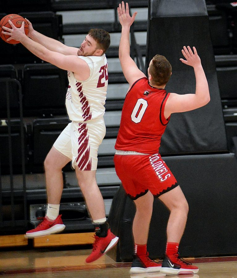 Harlan County senior forward Josh Turner pulled down a rebound against Whitley County's Trevor Downs during the Bears' 77-34 win Thursday.