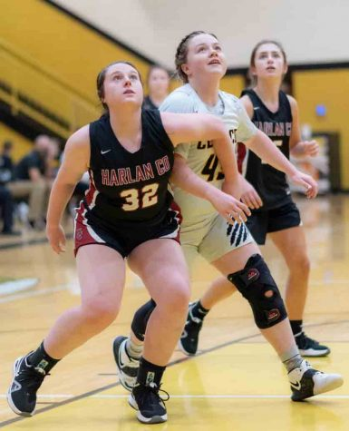 Harlan County senior guard Kelly Beth Hoskins battled for position in a recent game at Clay County.