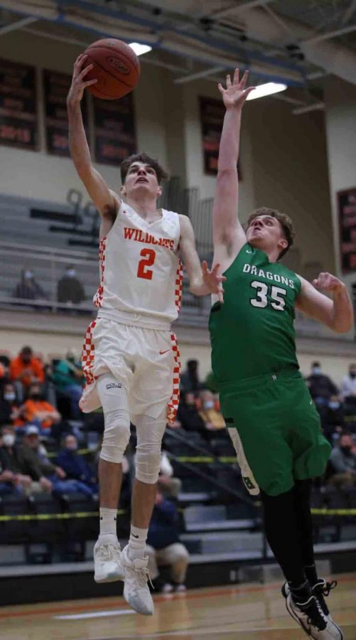 Lynn Camp's Spencer Gilbert went up for a shot against Harlan's Matthew Pennington in Tuesday's game. The host Wildcats edged Harlan 67-64.