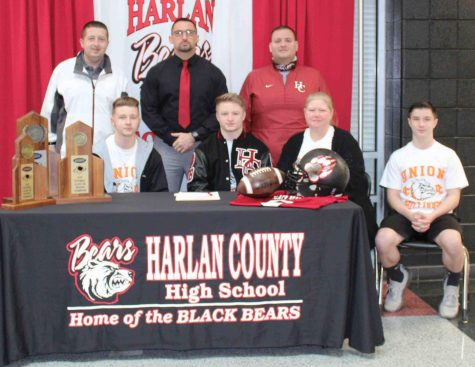 Harlan County High School senior Matt Brown signed with Union College on Thursday where he will continue his football career. Pictured with Brown at his signing ceremony are, front row, from left: Jacob Brown, Matt Brown, Shonda Brown and Jayce Brown; back row; HCHS athletic director Eugene Farmer, HCHS coach Eddie Creech and HCHS assistant coach Nick Bray.