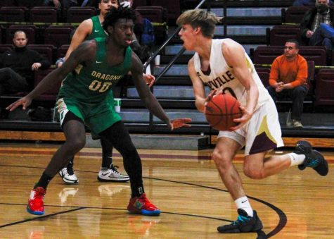 PIneville guard Keann Fuson worked against Harlan's Jordan Akal in Friday's game. Akal scored 33 in the Green Dragons' 69-54 victory. Fuson led PIneville with 20 points.