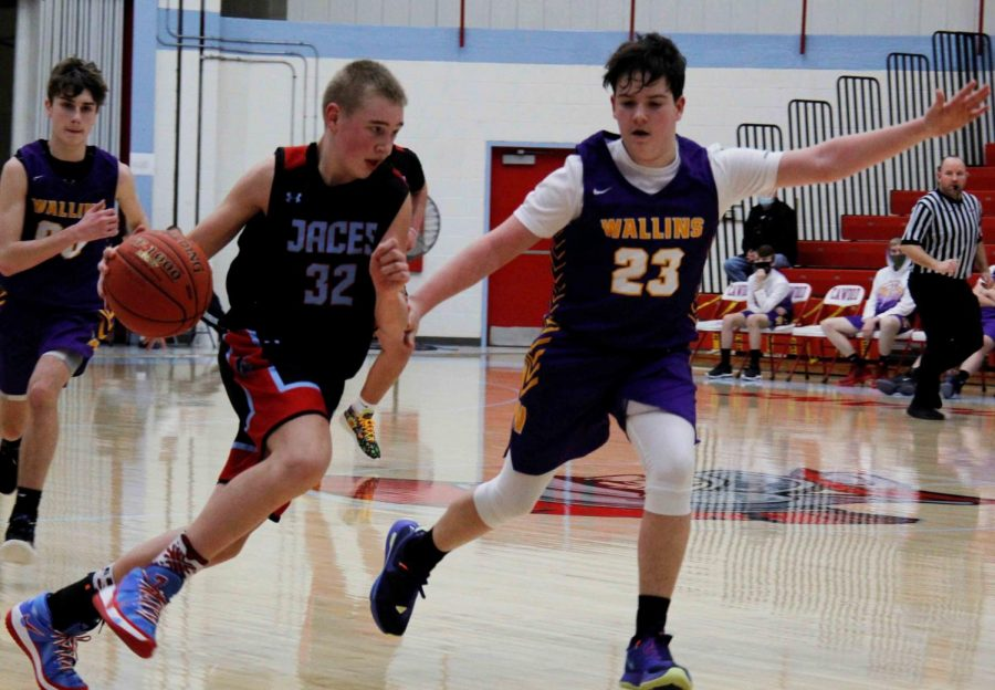 Wallins' Evan Simpson guarded James A. Cawood's Terry Delaney in middle school basketball action earlier this season. Wallins improved to 10-0 on the season with a win over the Trojans on Thursday.