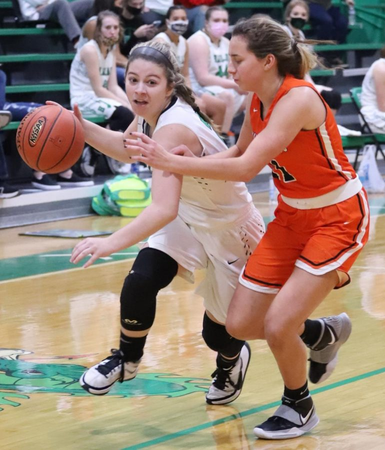 Harlan sophomore guard Emma Owens drove to the basket in action earlier this season. Owens scored 18 points in Harlan's 59-13 win Saturday at Barbourville.