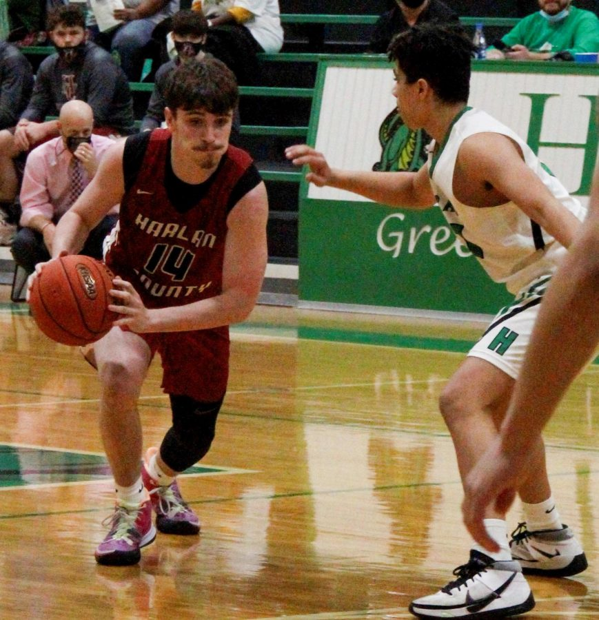 Harlan County's Tyler Cole drove against Harlan's Kyler McLendon in Friday's game.