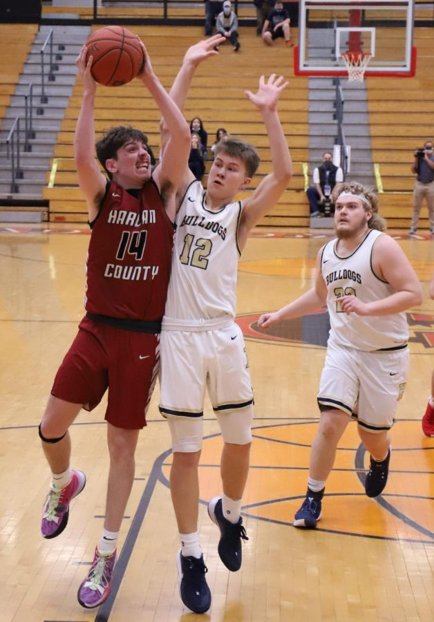 Harlan County's Tyler Cole went up for a shot as Samuel Shoptaw defended in action from the WYMT Mountain Classic. HCHS advanced with a 69-65 victory.