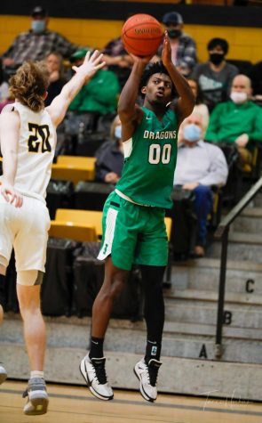 "Harlan guard Jordan Akal, pictured in action at Clay County, scored 18 points on Thursday as the Green Dragons fell to Lexington Christian in the state All ""A"" Classic."