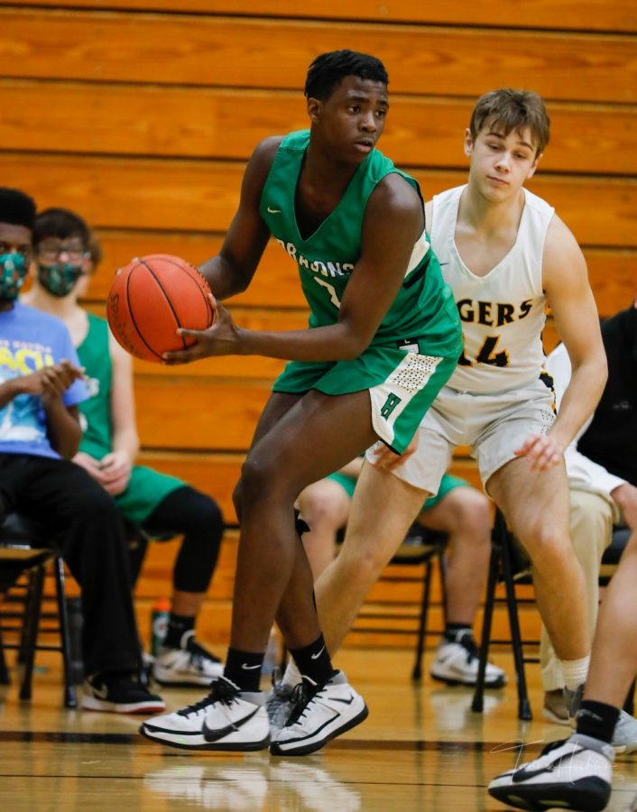 Harlan forward Will Austin looked for a teammate against pressure in Saturday's game at Clay County. The Dragons fell 83-69 on Tuesday at Hazard.