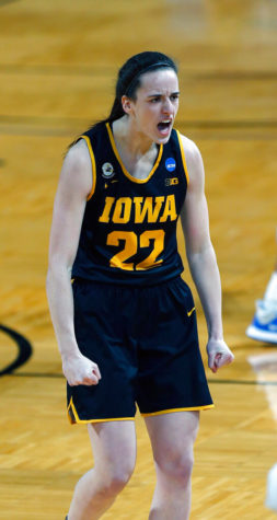 Iowa guard Caitlin Clark (22) reacted after hitting a 3-pointer during the first half of a game in the second round of the women