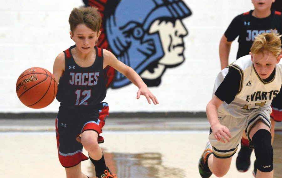 James A. Cawood's Easton Engle raced down the court on a fast break in action from the county tournament on Tuesday. JACES advanced to the finals with a 36-26 victory.