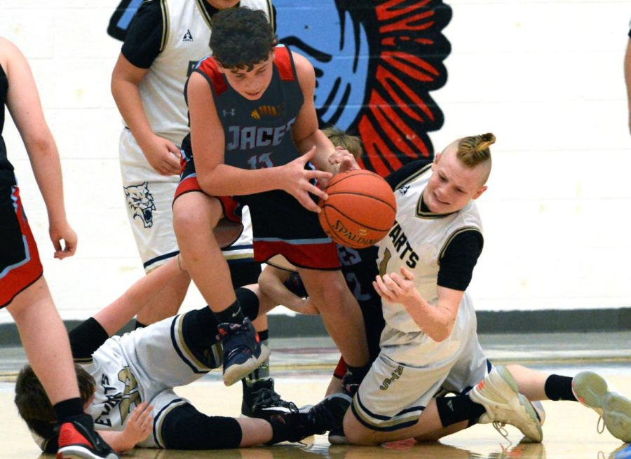 Tyhler Coots, of James A. Cawood, battled to break free with the basketball in county tournament action Tuesday. JACES advanced to a championship matchup against Rosspoint with a 36-26 win. The Trojans and Wildcats will play on Saturday at noon at Harlan County High School.