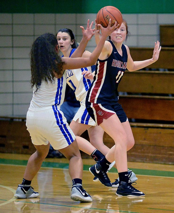 Harlan County's Jacey Lewis and Bell County's Nadine Johnson went after a loose ball in district championship action Thursday. Lewis scored 26 points to lead the Lady Bears. Johnson earned most valuable player honors as she hit all eight of her shots in a 17-point effort in Bell's 62-55 win.