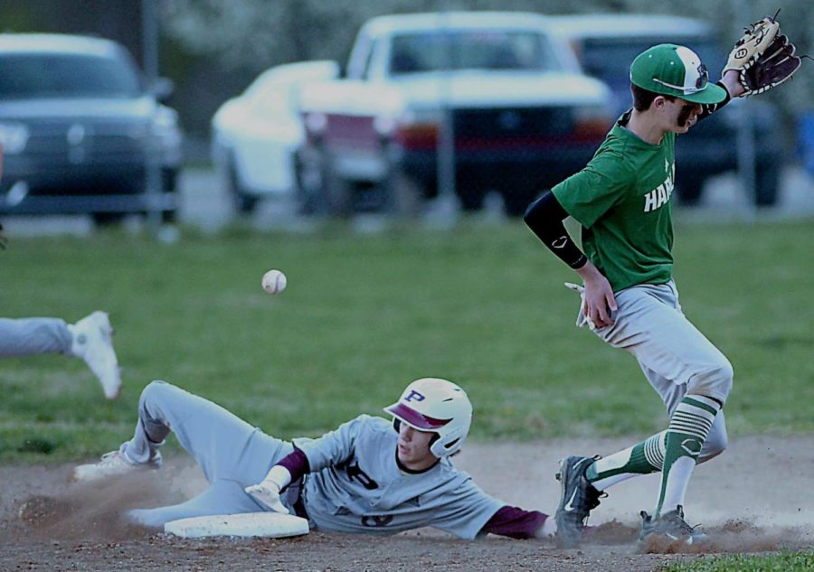 Harlan second baseman John Mark Bryson was unable to short hop a throw in high school baseball action Monday. Pineville rallied with eight runs in the seventh inning to win 12-6.