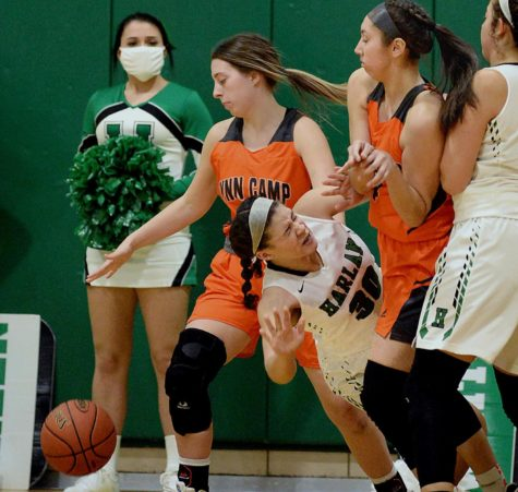 Harlan eighth-grade forward Kylie Noe went to the ground while battling inside in Friday